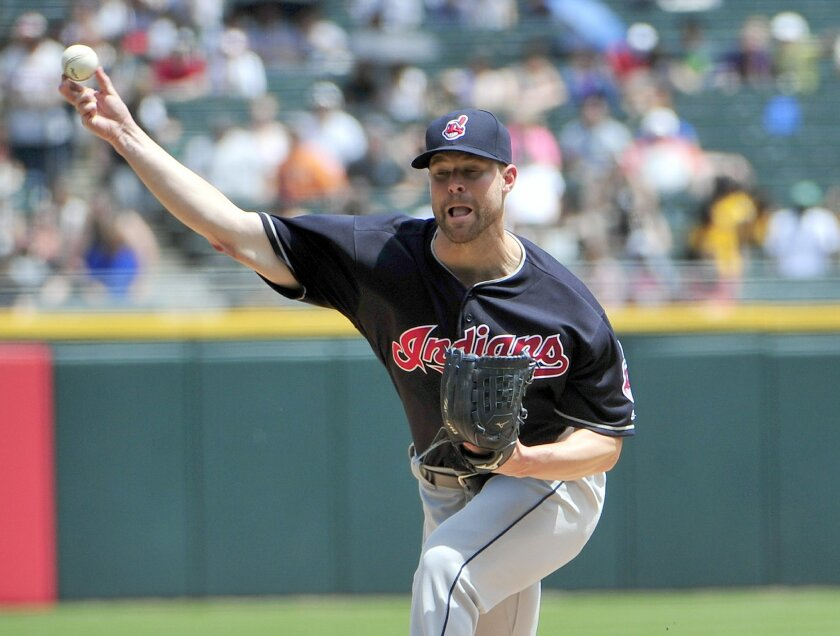 Cleveland Indians starting pitcher Corey Kluber throws against the Chicago White Sox during the first inning of a baseball game, Wednesday, May 25, 2016, in Chicago. (AP Photo/David Banks)