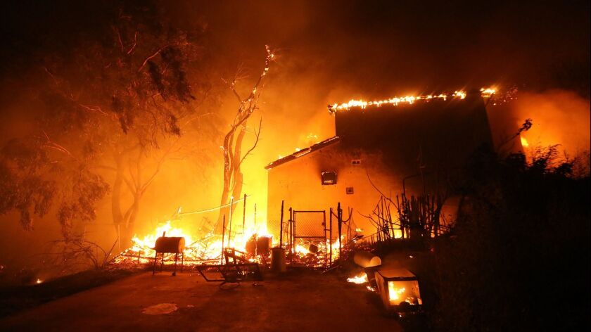 MALIBU, CA - NOVEMBER 9, 2018 - - The Woolsey fire envelopes a home in Malibu on November 9, 2018. (