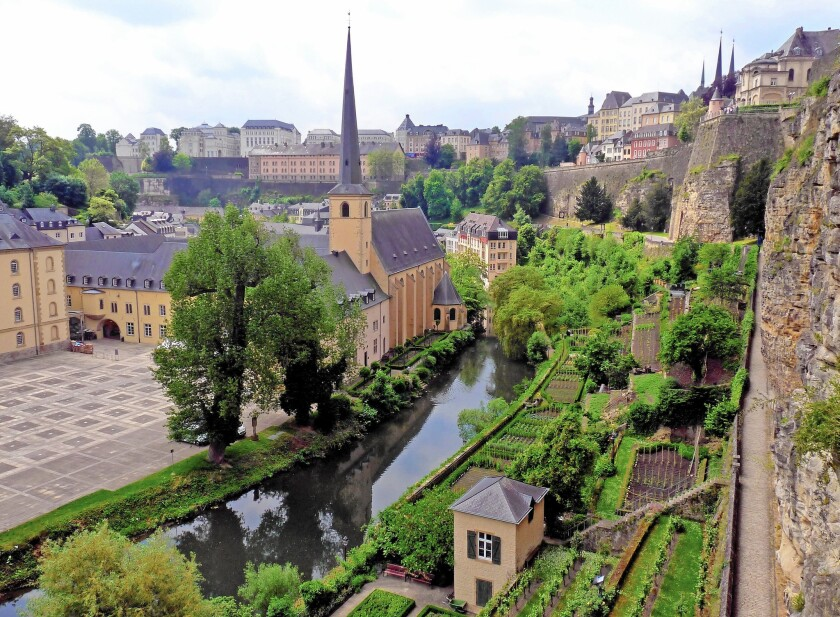 In the Old City of Luxembourg, cliffs whose tunnels shielded defenders overlook the former prison Neumunster Abbey in the Grund, now a trendy cultural area.