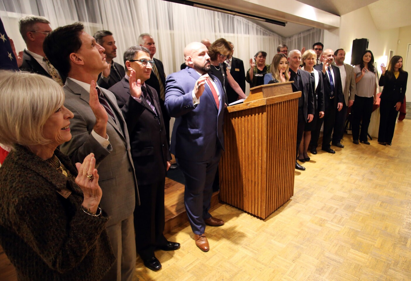 Installation of the 2019 Officers and Directors raise their right hand as they are sworn in during the La Cañada Flintridge Chamber of Commerce and Community Association 107th Installation and Awards Gala at the La Cañada Flintridge Country Club on Thursday.