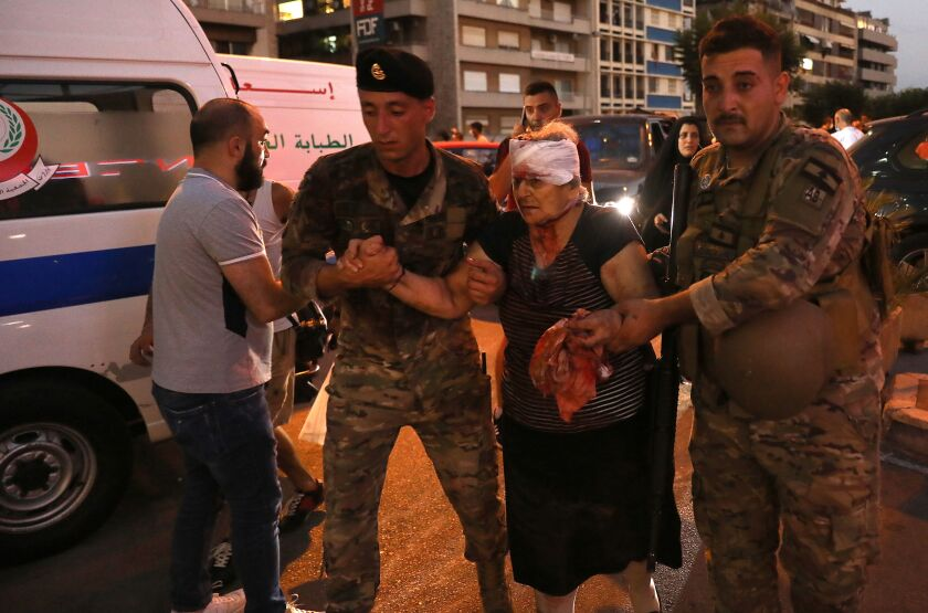 Wounded woman receives help after Beirut explosion