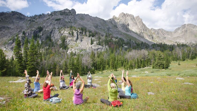 A yoga class is held in the natural splendor of the Double T River Ranch in Clyde Park, Mont.