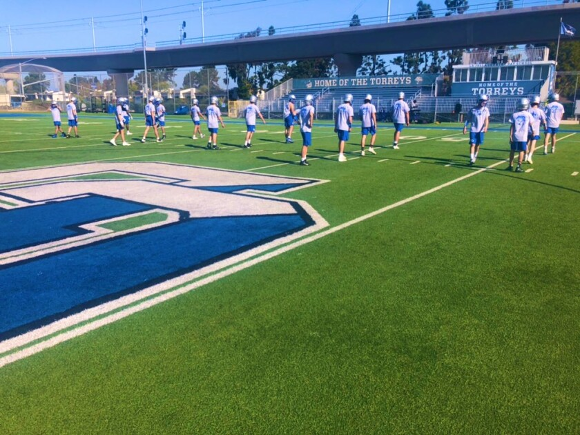 La Jolla Country Day School football players prepare for the new season with a coronavirus-cautious practice.