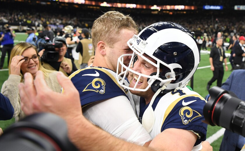 Rams quarterback Jared Goff hugs kicker Greg Zuerlein after defeating the New Orleans Saints in overtime on a field goal in the NFC Championship at the Superdome in New Orleans Sunday.