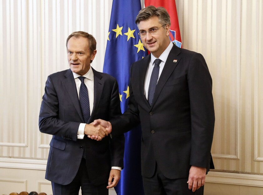 President of the European Council Donald Tusk, left, is welcomed by Croatia's prime minister Andrej Plenkovic in Zagreb, Croatia, Tuesday, Nov. 19, 2019. Donald Tusk attends the European Peoples Party (EPP) congress in Zagreb. (AP Photo/Darko Bandic)