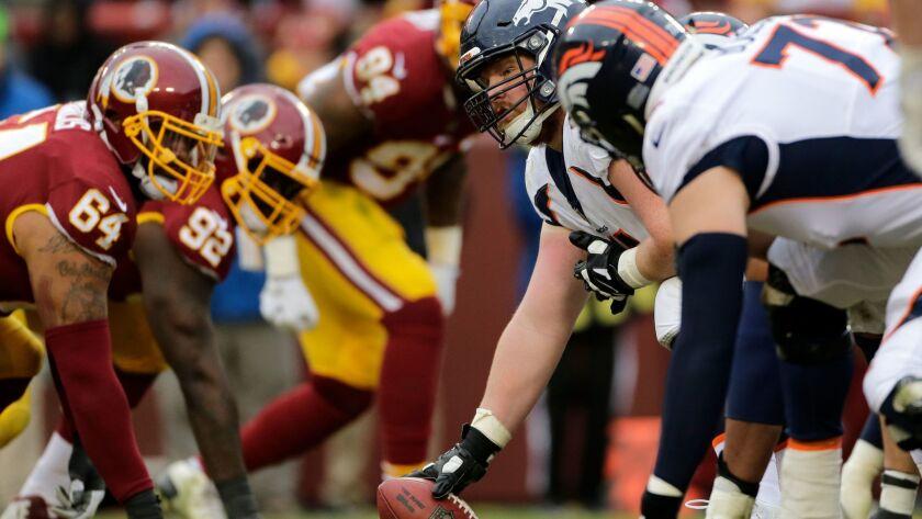 Denver Broncos center Matt Paradis prepares to snap the ball against the Washington Redskins.