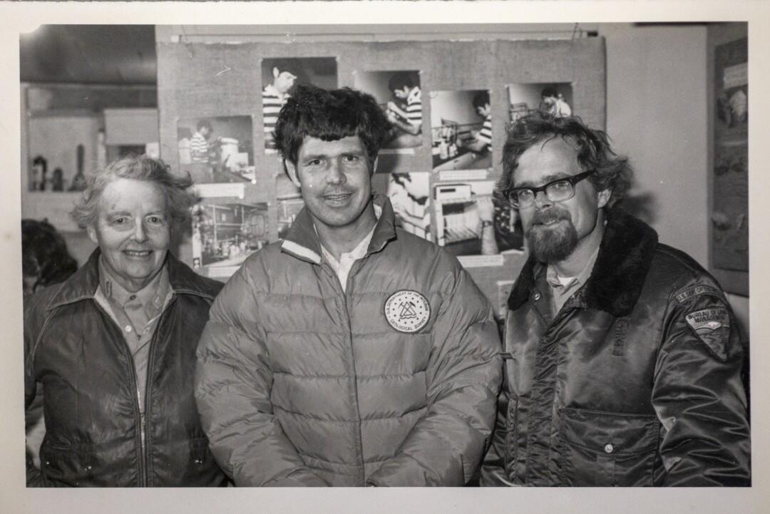 Three men inside a field office