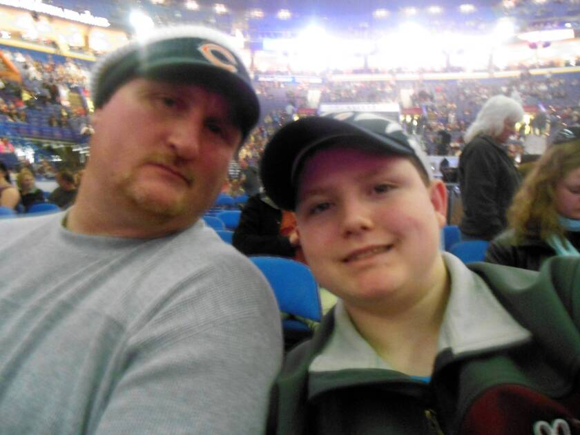 "Brad Lewis and his son, Jordan, in an undated photo. After Jordan's suicide, Brad posted a plea on Facebook: ""This bullying has to stop. People have to stop treating other people the way they do."""