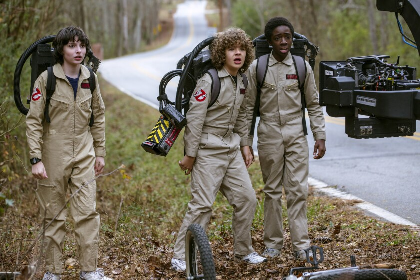 "Finn Wolfhard, left, Gaten Matarazzo and Caleb McLaughlin in ""Stranger Things."""