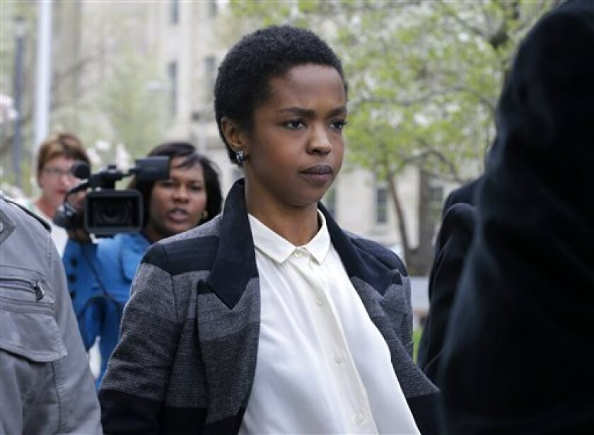 FILE - An April 22, 2013, file photo shows singer Lauryn Hill walking from federal court in Newark, N.J.   Hill has started serving a three-month prison sentence in Connecticut for failing to pay about $1 million in taxes over the past decade.  The Grammy-winning singer reported Monday July 8, 2013