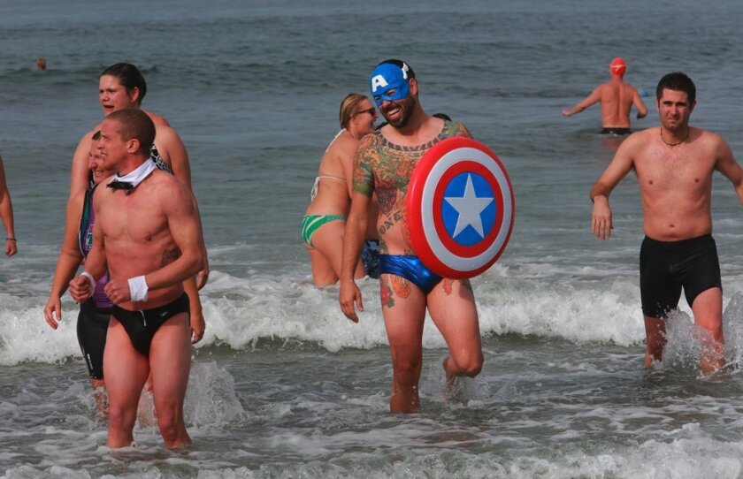 Mike Kelley, aka Captain America, took the plunge Tuesday with about 150 close friends at La Jolla Shores on the first day of the year. He has been doing the polar bear swim since he was a boy, he said..