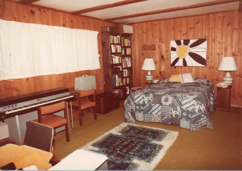 Inga's wood-paneled garage-conversion master bedroom in 1980.