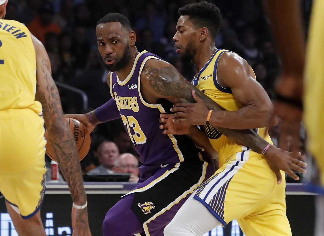LOS ANGELES, CALIF. - NOV. 13, 2019. Lakers forward LeBron James tries to work the ball inside against Warriors forward Glenn Robinson III in the first quarter at Staples Center in Los Angeles on Wednesday night, Nov. 13, 2019. (Luis Sinco/Los Angeles Times)