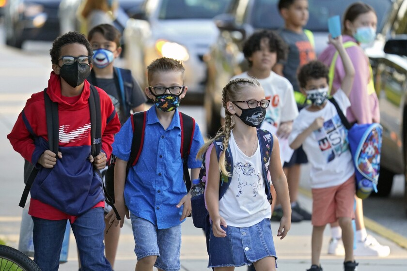 In this  file photo, students arrive for the first day of school at Sessums Elementary School in Riverview, Fla.