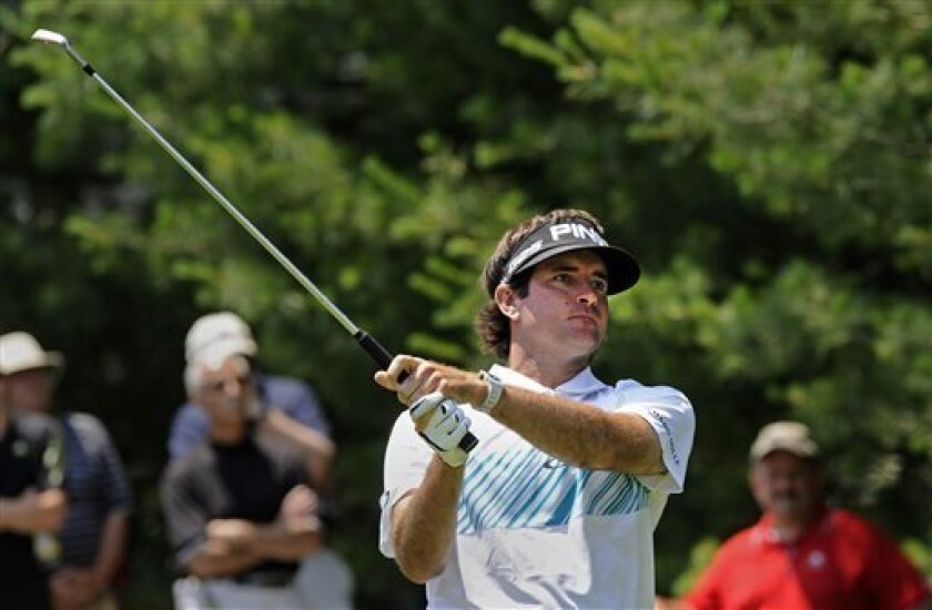 Bubba Watson watches his tee shot on the eighth hole during the second round of the Travelers Championship golf tournament in Cromwell, Conn., Friday, June 21, 2013. Watson shot a 3-under par 67 in his round, to go 10-under par for the tournament. (AP Photo/Fred Beckham)