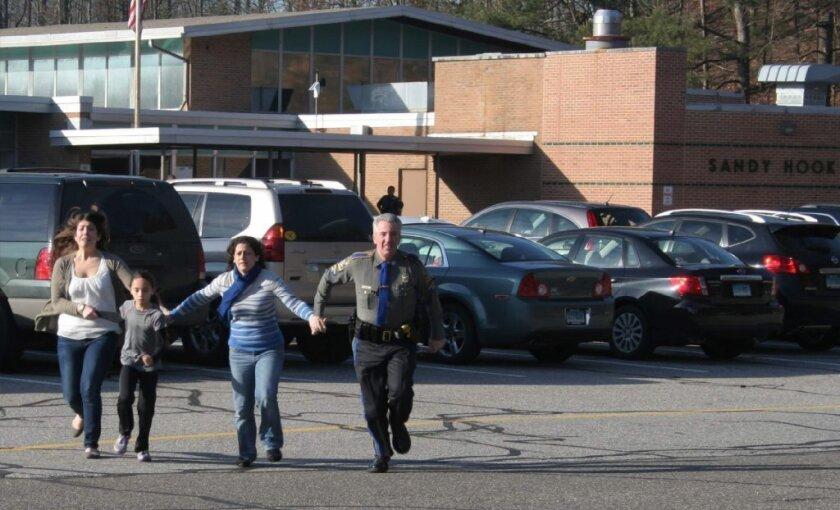 People flee shooting at Sandy Hook Elementary School in Newtown, Conn.