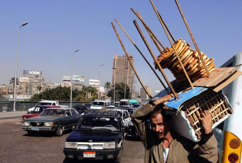 Egypt street vendors, store owners say Morsi is bad for business
