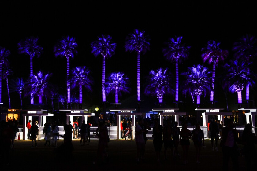 Trees surrounding the Polo field were aglow in purple, a desert tribute to Prince following his death, on opening night of Weekend 2 of the Coachella Valley Music and Arts Festival in Indio on April 22, 2016.