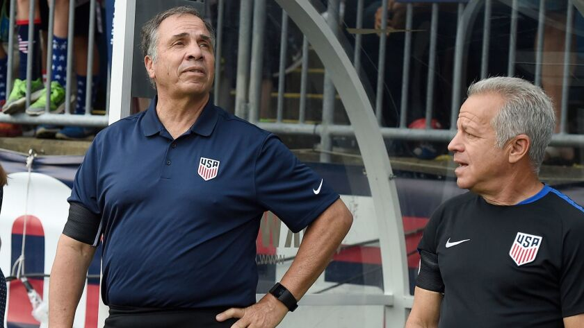 U.S. men's national soccer team coach Bruce Arena, left, and assistant coach Dave Sarachan watch team introductions before a July 1 game against Ghana in East Hartford, Conn.