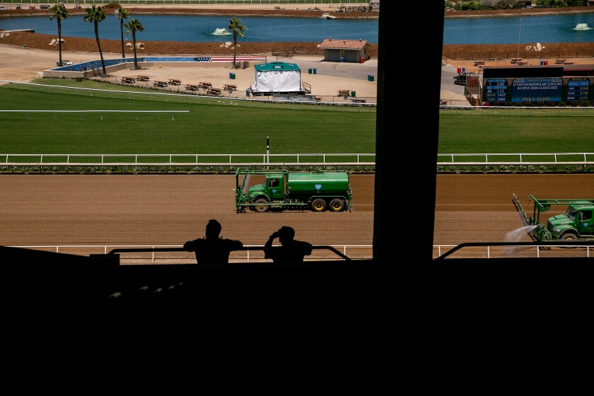 Workers groom the tracks at Del Mar Racetrack