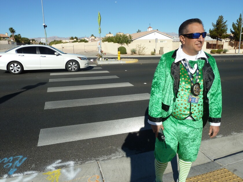 Tom Rainey walks across the street in Las Vegas dressed as a leprechaun as part of a police operation to see if motorists will stop for him in a city with a rising toll of pedestrian deaths. They didn't.
