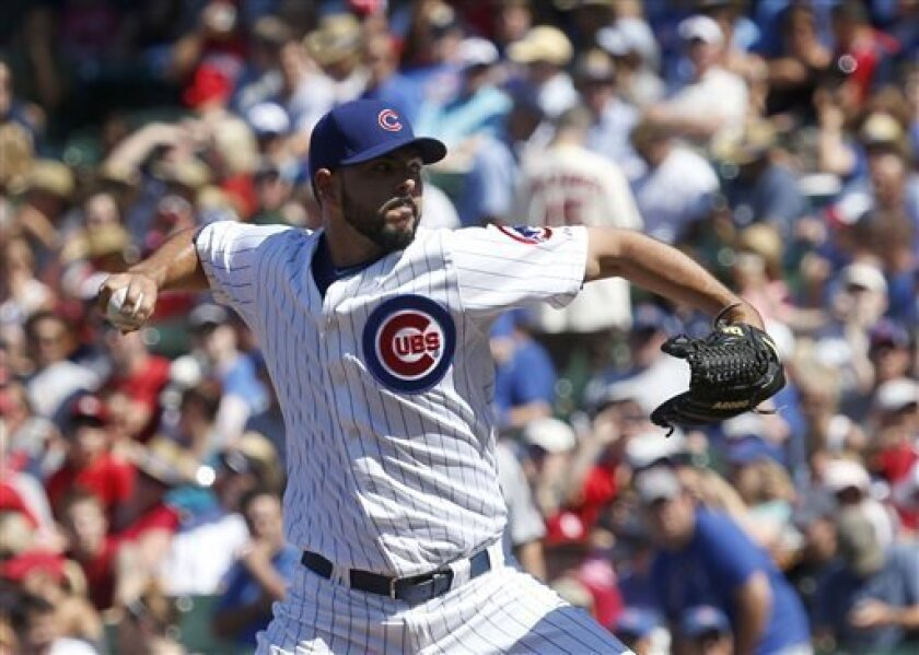 Chicago Cubs starting pitcher Carlos Villanueva delivers during the first inning of a baseball game against the St. Louis Cardinals Friday, July 12 2013, in Chicago. (AP Photo/Charles Rex Arbogast)