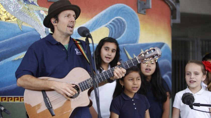 Jason Mraz is shown singing in 2014 with students at Oceanside's Burbank Elementary School.