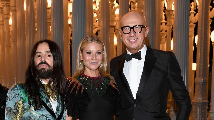 Alessandro Michele, left, Gwyneth Paltrow and Gucci's chief executive officer Marco Bizzarri attend Los Angeles County Museum of Arts' sixth annual Art + Film gala honoring Robert Irwin and Kathryn Bigelow.