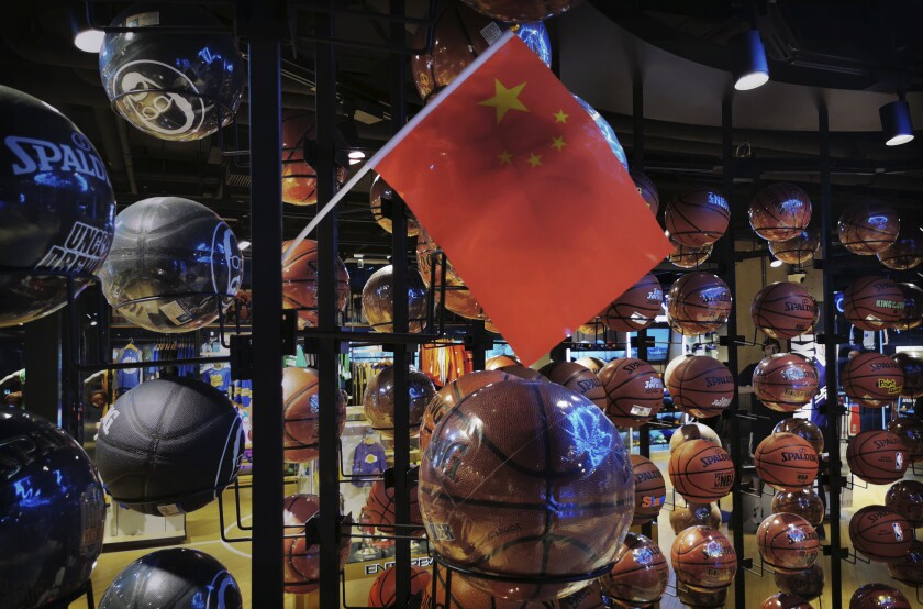 A Chinese flag is placed on basketballs at the NBA's flagship retail store on Wednesday in Beijing.