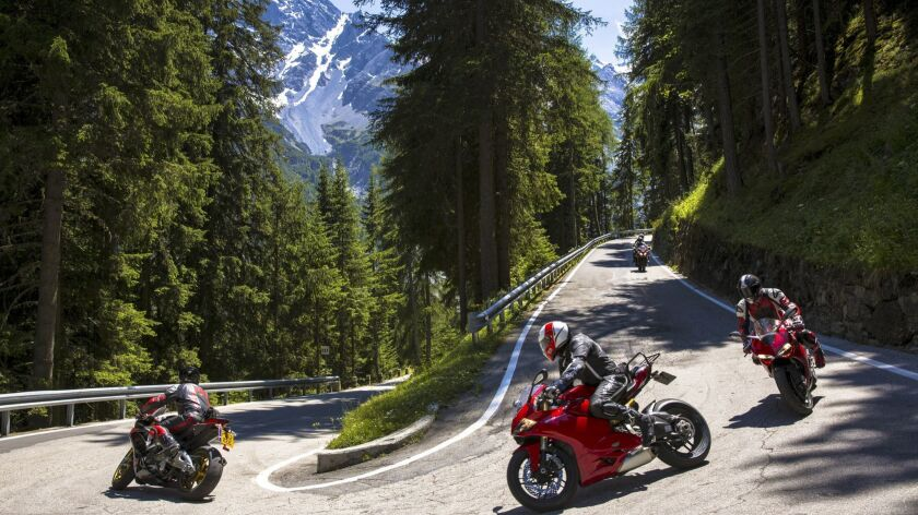 Motorcycles on Stelvio Pass in the Alps, Italy