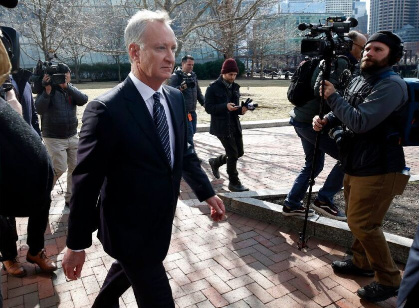 Toby Macfarlane in April departs federal court in Boston after facing charges in a nationwide college admissions bribery scandal.