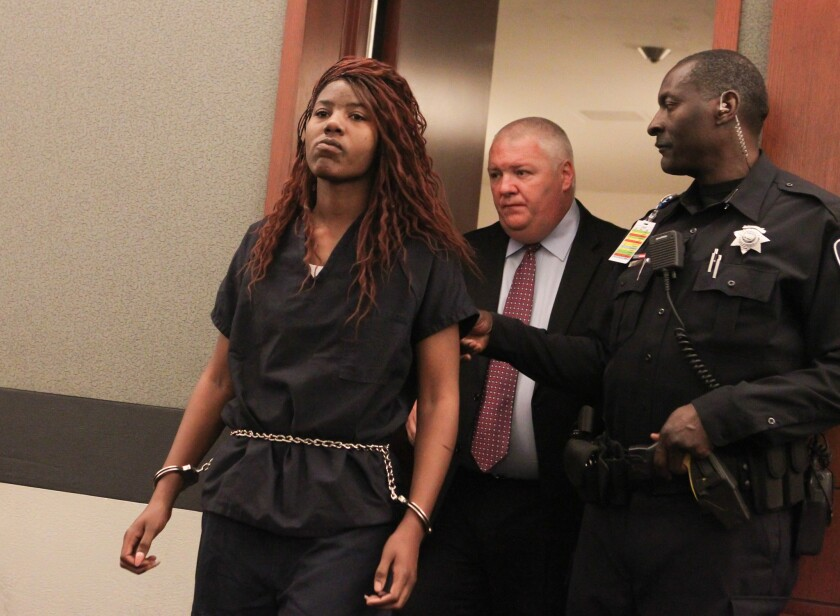 Lakeisha Nicole Holloway enters district court with one of her public defenders, Scott Coffee, for her arraignment on Dec. 23, 2015, in Las Vegas.