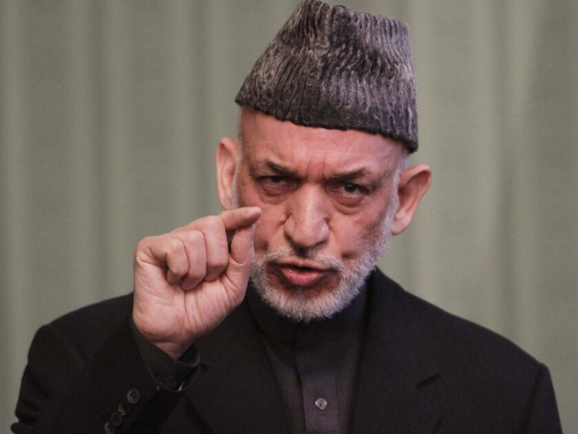 Afghan President Hamid Karzai speaks to journalists during a press conference in Kabul. Karzai said that Washington needs to make concrete steps towards peace with the Taliban before Afghanistan will sign an agreement to allow a continued U.S. military presence in his country.