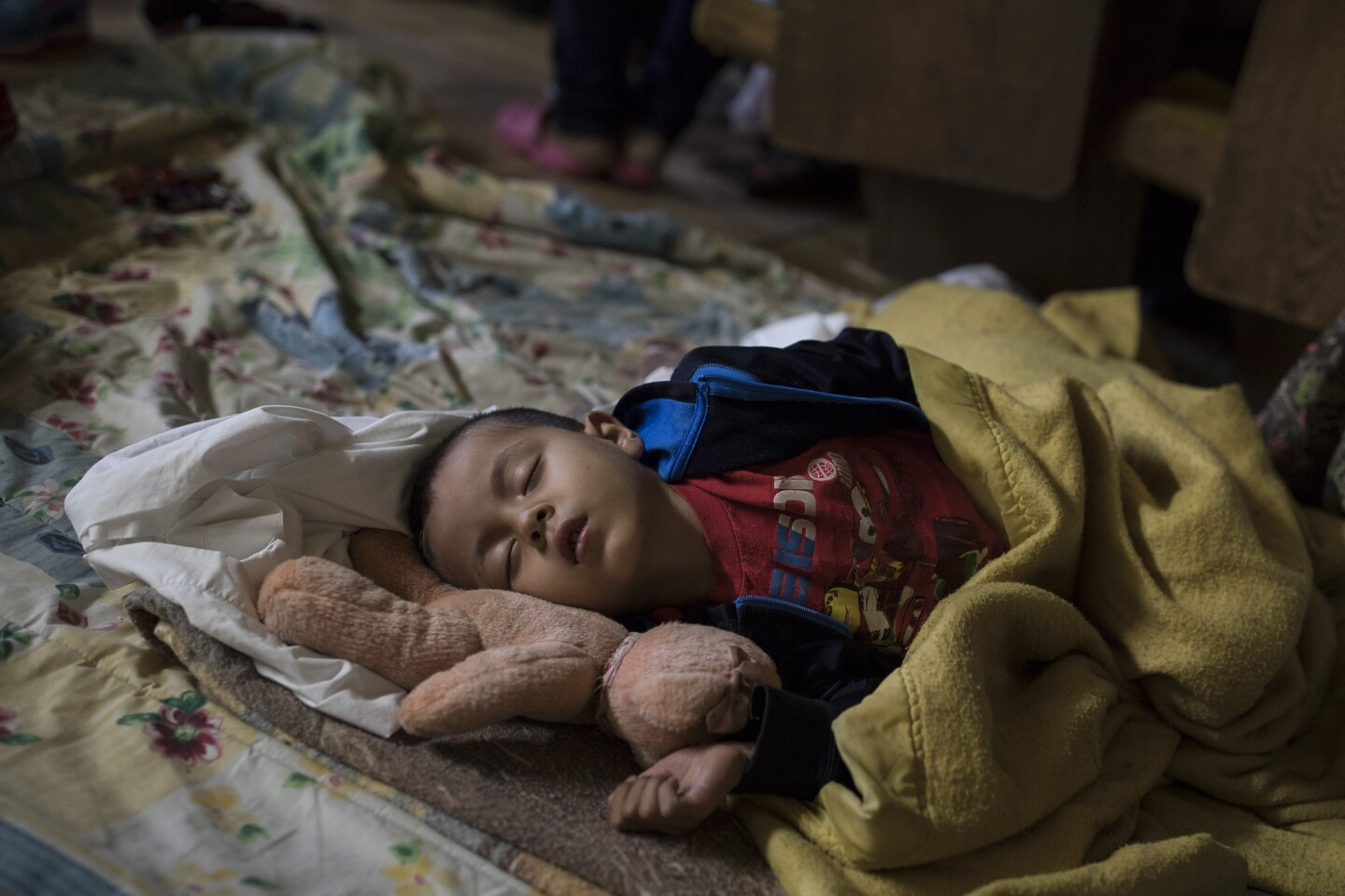 A Central American child who is traveling with a caravan of migrants sleeps at a shelter in Tijuana, Mexico, on April 29, 2018. U.S. immigration lawyers are telling Central Americans in a caravan of asylum-seekers that traveled through Mexico to the border with San Diego that they face possible separation from their children and detention for many months.
