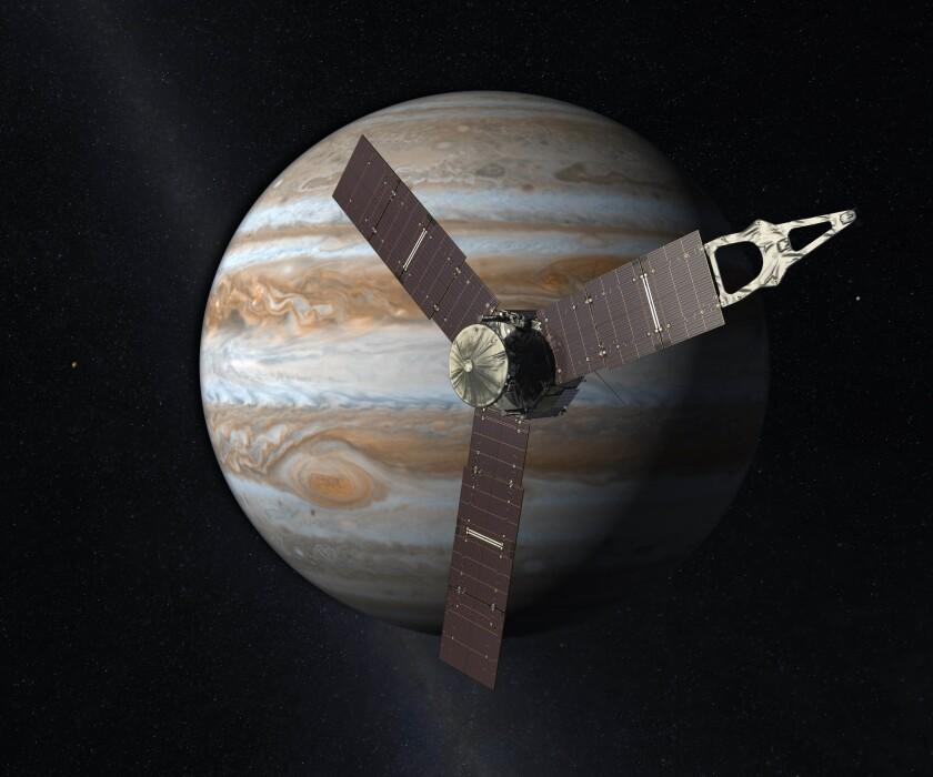 En esta interpretación artística creada por la NASA y JPL-Caltech se ve la nave espacial Juno mientras sobrevuela Júpiter. Juno entró a la órbita del gigantesco planeta de gas el 4 de julio de 2016, cinco años después de su lanzamiento. (NASA/JPL-Caltech vía AP)