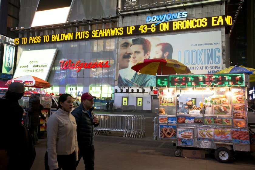 A news ticker displays the score in Times Square after the Seattle Seahawks defeated the Denver Broncos in the NFL Super Bowl XLVIII football game, Sunday, Feb. 2, 2014, in New York. The Seahawks won 43-8. (AP Photo/Matt Rourke)
