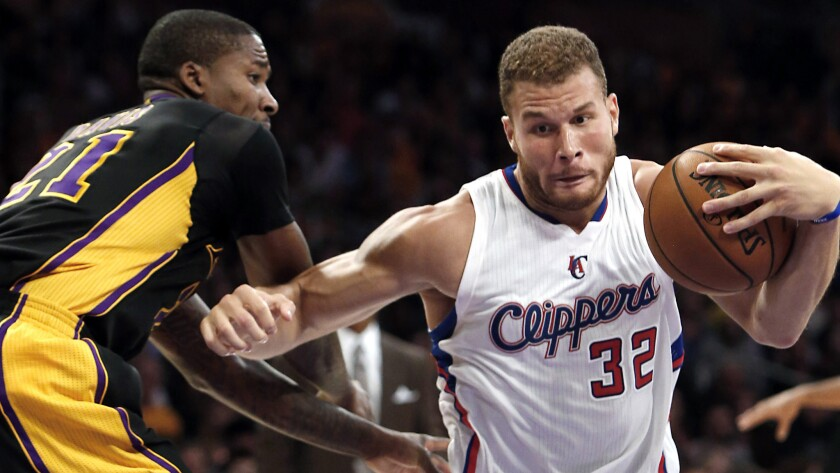Clippers forward Blake Griffin, right, drives past Lakers forward Ed Davis during the Clippers' win on Oct. 31 at Staples Center.