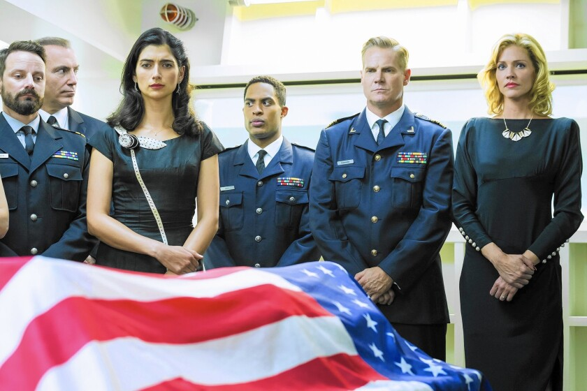 "Ryan Robbins, left, Al Sapienza, Tiffany Lonsdale, Brandon P. Bell, Brian Van Holt and Tricia Helfer in ""Ascension."""