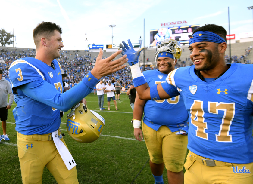 UCLA's Shea Pitts, right, celebrates with teammate Wilton Speight following a win over Cal in November 2018.