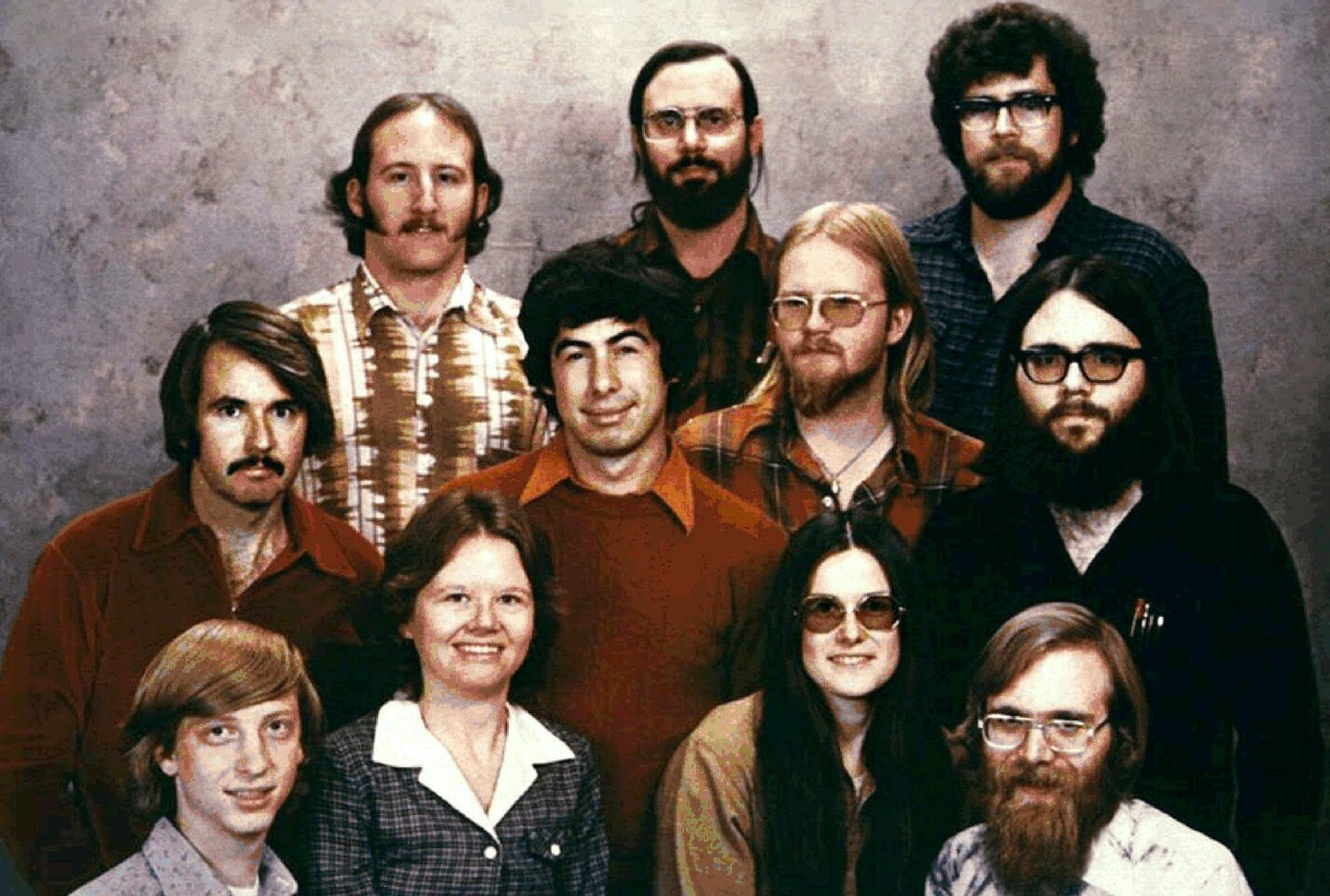 In this 1978 file photo provided by Microsoft, the 11 people who started Microsoft Corp., are photographed in Albuquerque, N.M., just prior to moving the company to the Seattle area. Shown, top row from left, are: Steve Wood, Bob Wallace and Jim Lane; second row, Bob O'Rear, Bob Greenberg, March McDonald and Gordon Letwin; and front row, Bill Gates, Andrea Lewis, Marla Wood and Paul Allen.