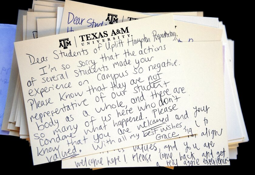 This Monday, Feb. 15, 2016, photo shows a letter addressed to visiting students from Uplift Hampton Preparatory sits atop a stack of similar notes at Texas A&M University in College Station, Texas. Texas A&M University System Chancellor John Sharp apologized Tuesday to high school students for raci