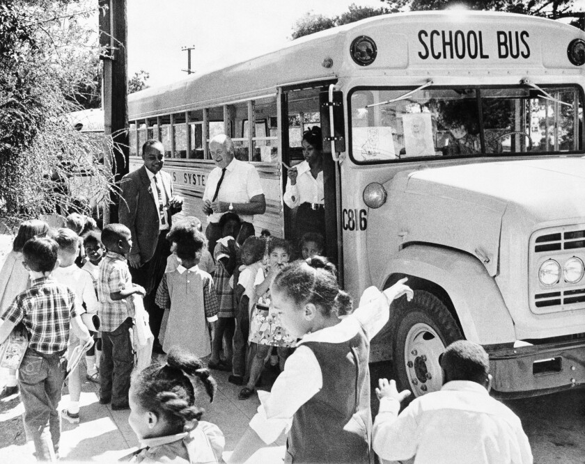 Youngsters head for a school bus in Berkeley, California on Feb. 24, 1970, where a busing program to