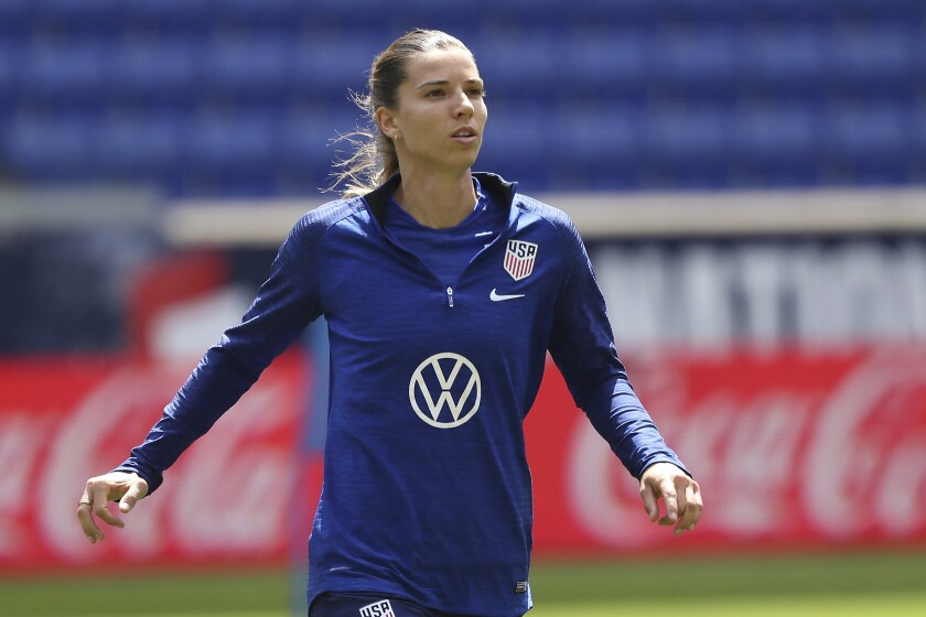 Tobin Heath warms up before a soccer match.
