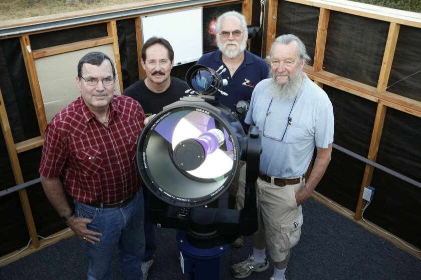 Scott Baker (left to right), Mike Leigh, Bob Austin and Chuck Kimball joined in Baker's backyard rural Julian observatory with his 14-inch Mead LX200 Schmidt Cassegarian telescope getting ready for the Julian Starfest. John R. McCutchen / Union-Tribune photos