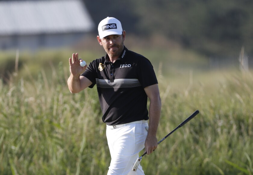 Louis Oosthuizen acknowledges the crowd after making an eagle on No. 14 during the second round of the British Open.