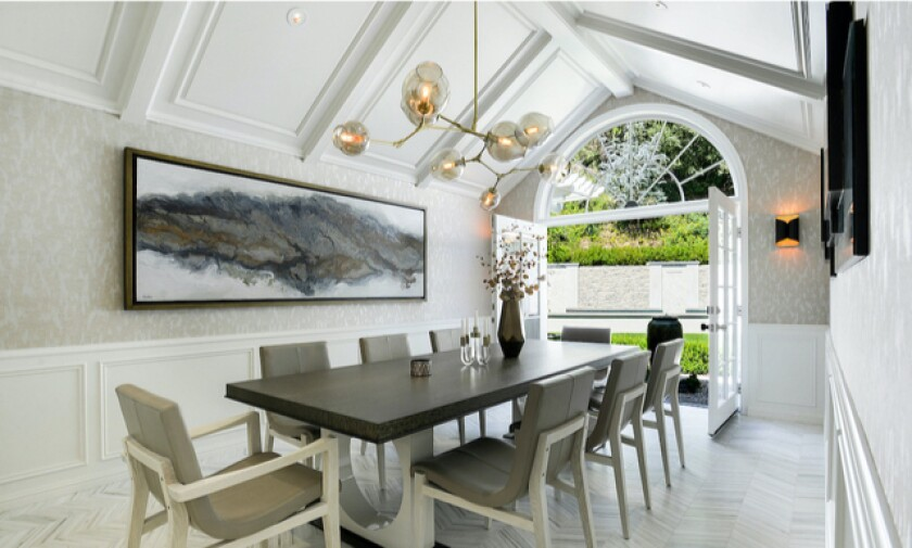 French doors off the dining room open to the backyard at the recently remodeled house Doug Ellin is trying to sell.