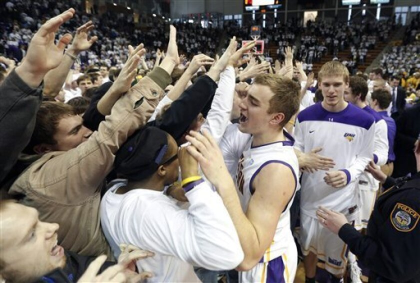 Northern Iowa forward Chip Rank, center, celebrates with fans after defeating Wichita State in an NCAA college basketball game, Saturday, Feb. 2, 2013, in Cedar Falls, Iowa. (AP Photo/Matthew Putney)