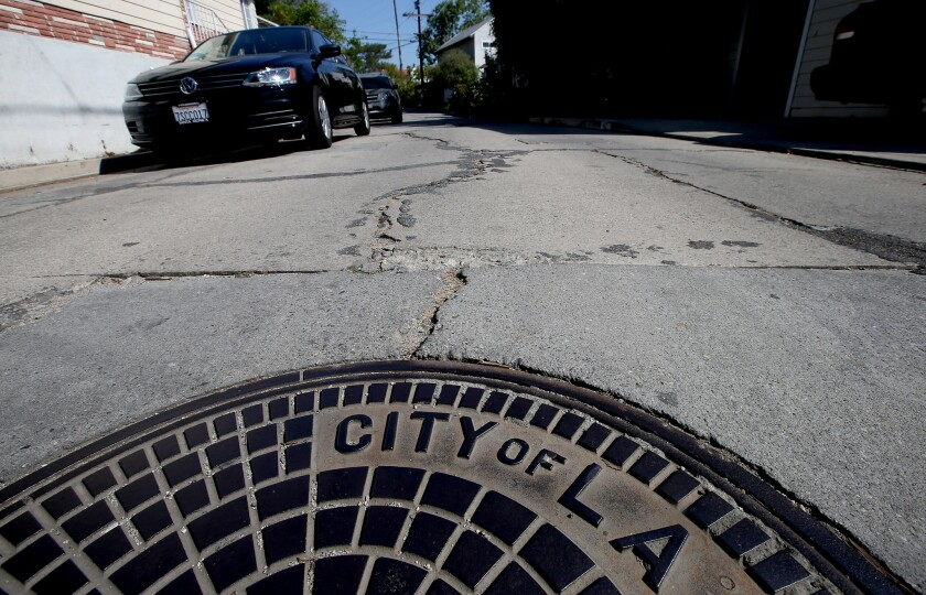 A concrete street in Mount Washington is lined with deep rifts, uneven patches and long cracks. The area has some of the worst streets in Los Angeles.