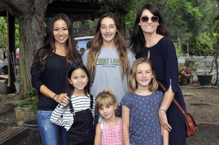 Jenn Lau with Gia, Shay with Sage, mom Michelle Mathis with Lexi
