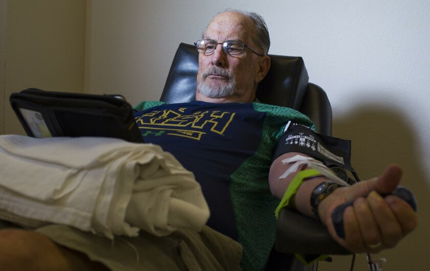 Stephen McMeeken donates blood platelets at the San Diego Blood Bank's East County donor center on Monday. The Alpine retiree has donated nearly 153 gallons of blood products, making him the top donor in Blood Bank history.